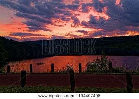 A cloudy sunset at Locust Lake State Park Schuylkill County Pennsylvania USA.