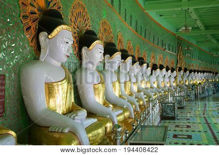 SAGAYN, MYANMA - DECEMBER 23, 2016: Sculptures of seated Buddhas in the cave pagoda U Min Thonze
