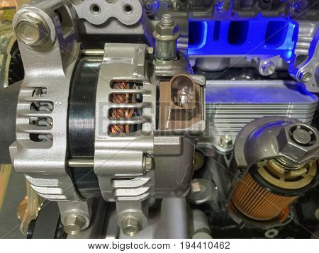 Car alternator and engine oil filter cross section , display inside materials .