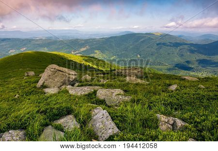 Rocks On Grassy Hillside Of Carpathian Mountains