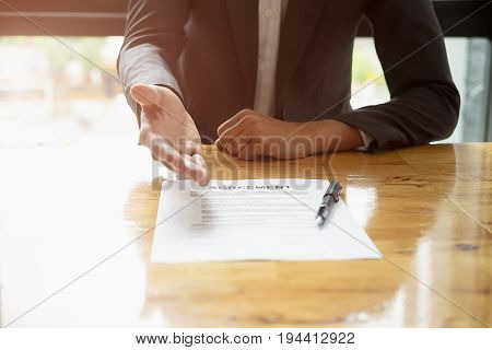 Close Up Business Man Reaching Out Sheet With Contract Agreement Proposing To Sign.full And Accurate