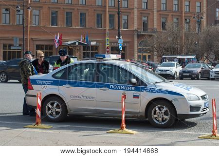 SAINT PETERSBURG, RUSSIA - APRIL 10, 2017: Inspector of traffic police drafts a Protocol on administrative offense