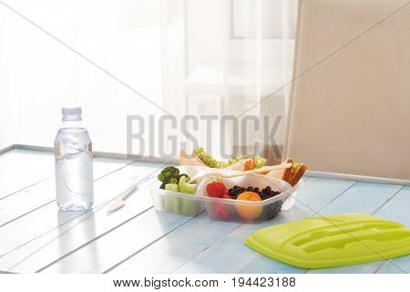 Full lunch box of healthy food on wooden table with copy spaceHealthy lunch concept