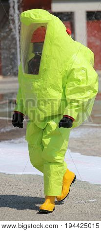 Firefighter With Protective Suit Against  Bacteriological Agents