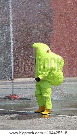Man With Protective Suit Against Chemical And Bacteriological Ag