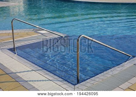 Swimming Pool With Ladder And Steel Handrail In A Spa