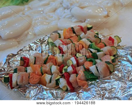 Uncooked Fish Kebabs And Vegetables