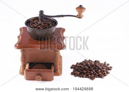 Mill for grinding grain on a white background