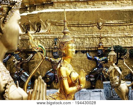 golden angle, Kinnaree (Native Thai Style of half angle half bird sculpture) sculpture in temple of emerald Buddha. BANGKOK, THAILAND