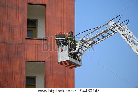 Bucket Truck With Firefighters During Exercise In The Firehouse