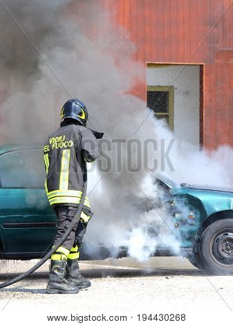 Incident Car With Black Smoke And An Italian Firefighter With Th