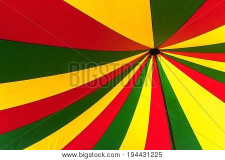 Circus tent in green yellow and red view from below in the top abstract colorful background