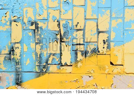 Bright blue and yellow tiles from Ukraine. Magnification with tiles on a sunny day. National flag of Ukraine