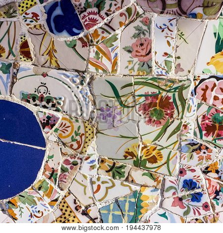 mosaic tile decoration broken glass Park Guell, Barcelona, Spain. Designed by Gaudi