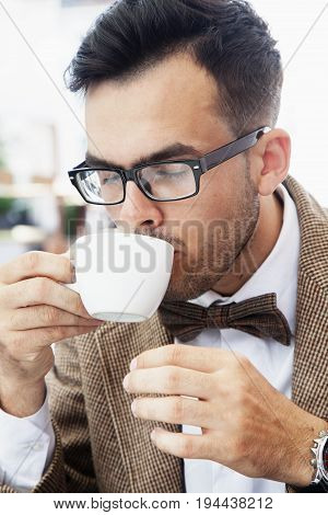 Coffee time. Sucessful businessman enjoying in a cup of coffee