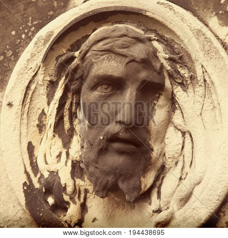 fragment of antique statue Jesus Christ as a symbol of love faith and religion.