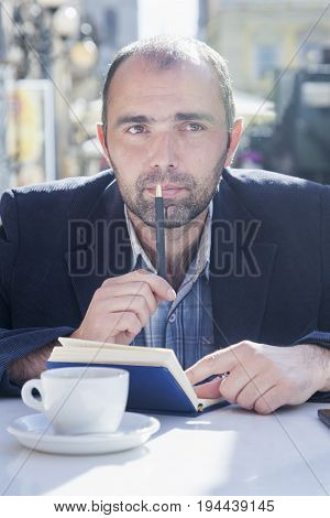 Successful businessman planning his workday. Time management concept. (Freedom freelance success money concept)