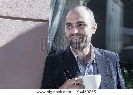 Coffee Break. Sucessful businessman enjoying in a cup of coffee