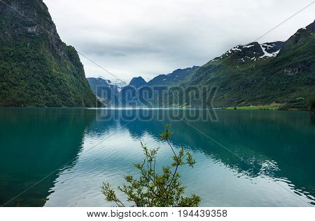 The mountain lake Oldenvatnet with the glacier Briksdal in Norway.