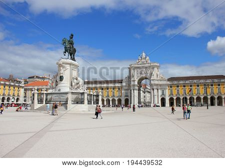Commerce Square (Praca do Comercio), Triumphal Arch (Arco da Rua Augusta) and Statue of King Jose I in Lisbon, Portugal. Popular city center attraction with colorful buildings on summer day background