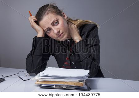 Stress for professional burnout. Portrait of exhausted and tired business woman in the office (Depression sadness problems difficulties concept)
