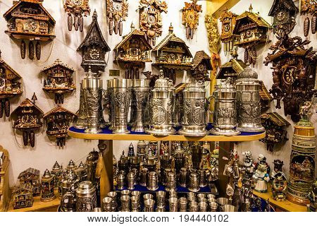 Munich, Germany - July 9, 2017: Beer cups and cuckoo clocks in a souvenir shop in Munich, Bavaria, Germany