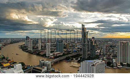 Aerial view over Bangkok modern office building in bangkok business zone near the river with sunset sky in Bangkok Thailand