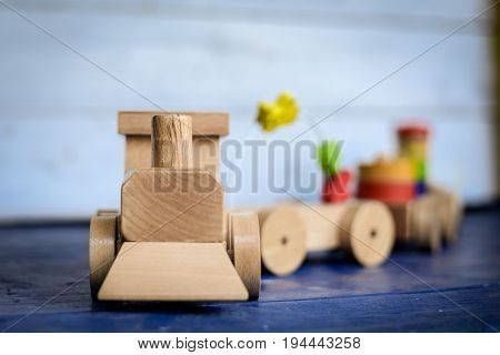 Wooden locomotive and loaded wagons made from colorful wooden blocks