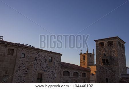 Historic building towers at sunset. Illuminated by last ray of sun Caceres Spain
