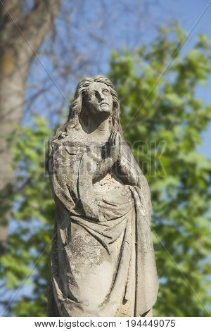 Statue of Virgin Mary as a symbol of love and kindness (Religion faith death concept)