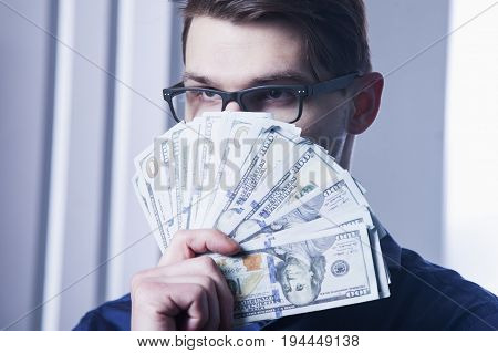 I love a money. Satisfied man with smiling face holding US. (Wealth business success profit concept)