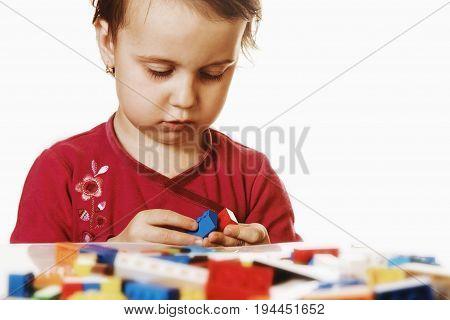 little cute girl playing indoors (developmental toys for children)