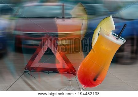 Cocktail glass with melon tip over in the background car crash scene intentionally blurred. Symbolic of alcohol consumption when driving.