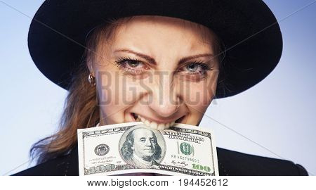 Happy young successful Business Woman bites money (Wealth famine abundance  happiness)