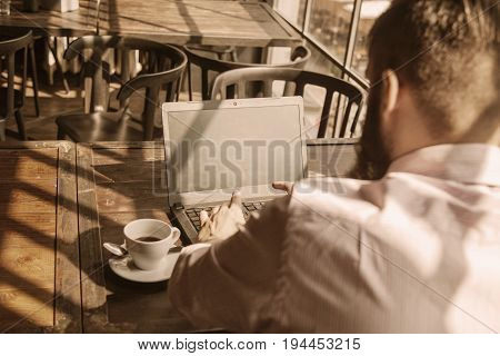 Young male freelancer working with laptop computer (Freelance freedom success development)