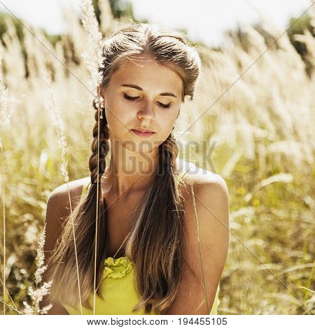 Femininity. Beauty portrait of a young beautiful brunette girl with long black straight hair.