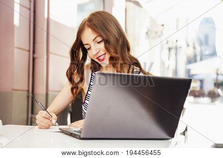beautiful woman working working with a laptop outdoors (freelance time management success freedom)