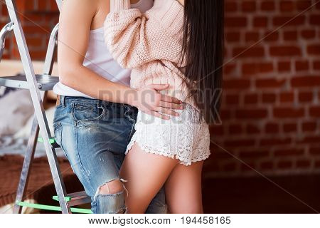Romantic couple. Passion time. Young loving couple embracing and looking to each other at home