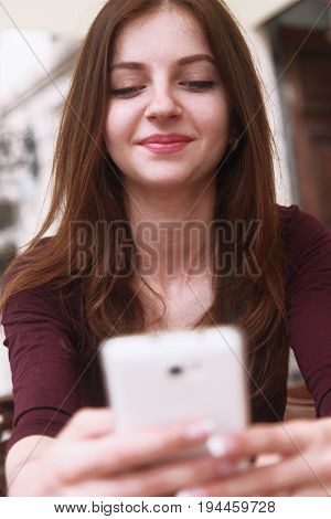 Social Media addiction. young beautiful woman holding a smartphone (psychological problems media mania)