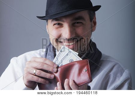 Young man with smiling face holding US dollar money and paying cash (Buy bills payment concept)