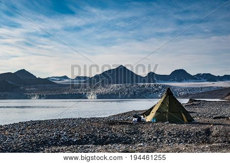 Campsite tents in Svalbard at glacier front