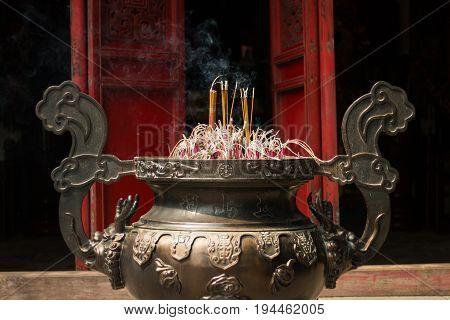Joss stick bowl in a temple in Hanoi Vietnam