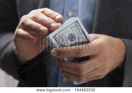 Businessman with money in hand. (Success freedom financial prospects career advancement)