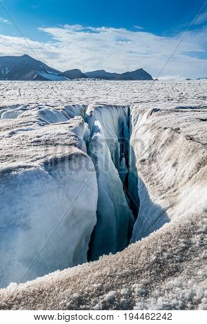 Fissure in top surface of a glacier Svalbard