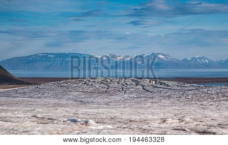 View of front of glacier from the top surface Svalbard