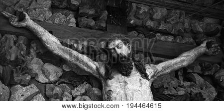 crucifixion of Jesus Christ as a symbol of resurrection and immortality of the human soul (old wooden statue)