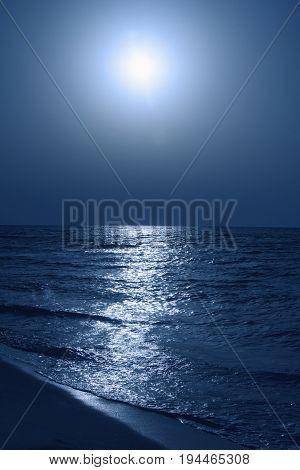 Fantastic blue sea background. Mediterranean Sea at night. Moon reflecting in a sea
