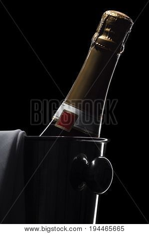 Champagne bottle in bucket isolated on black background