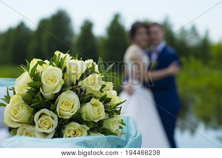 wedding flowers, bouquet, newlyweds hugging on the nature, love