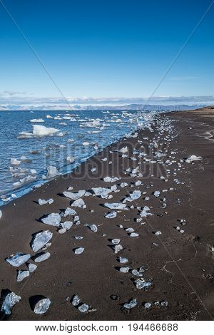 Small icebergs lying on a beach Svalbard